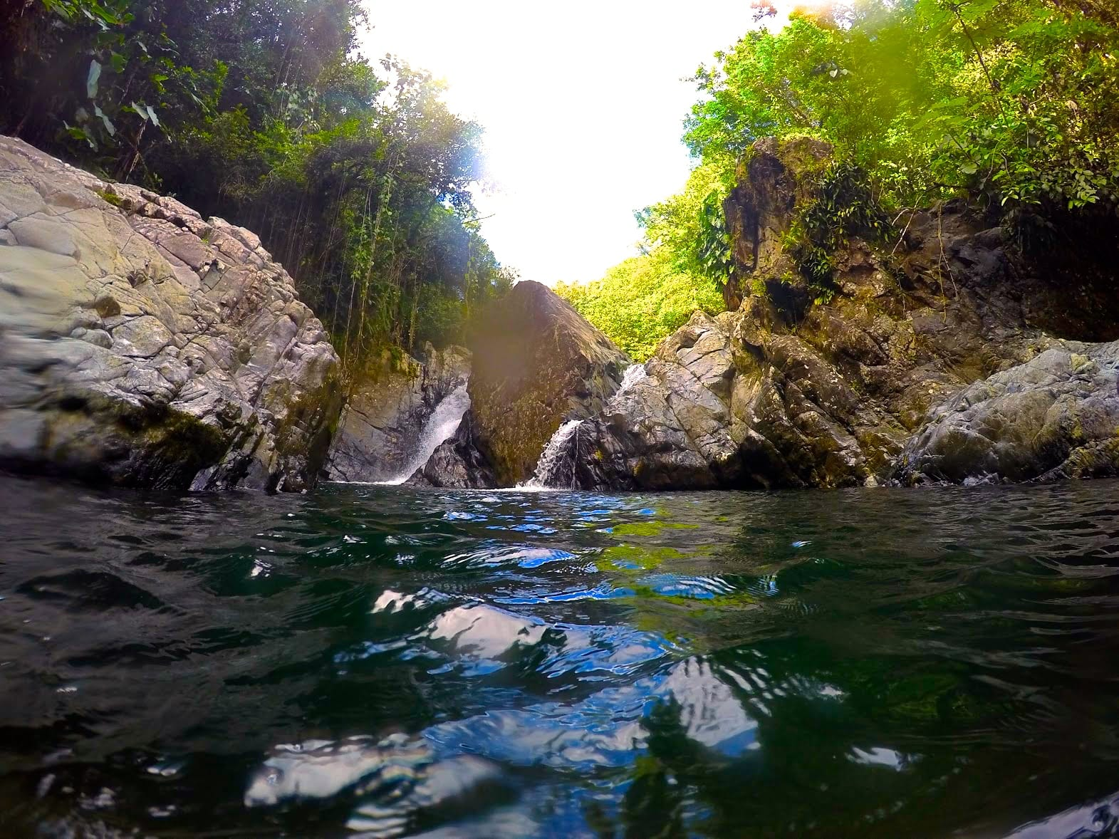 Photo of the natural waterfalls and the 50 ft cliff that we jumped off at Rio Tinajas.