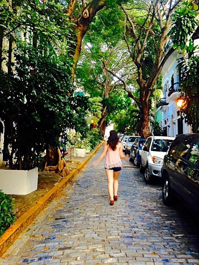 Me walking along a cobblestone street in Old San Juan