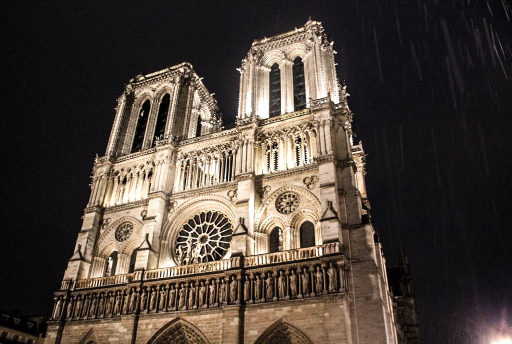 The cathedral Notre Dame, the most famous church is Paris, lit up at night. Photo taken by Josie Lucero