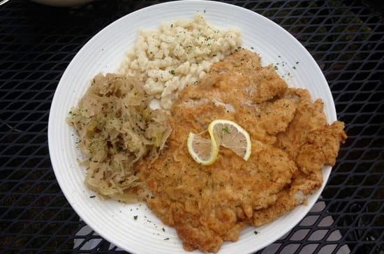 A typical plate of Schnitzel with Spätzle and sauerkraut from a restaurant in Frankfurt, Germany. Photo taken by Josie Lucero.