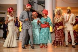 Omo and Eulanda dancing in traditional Nigerian attire.